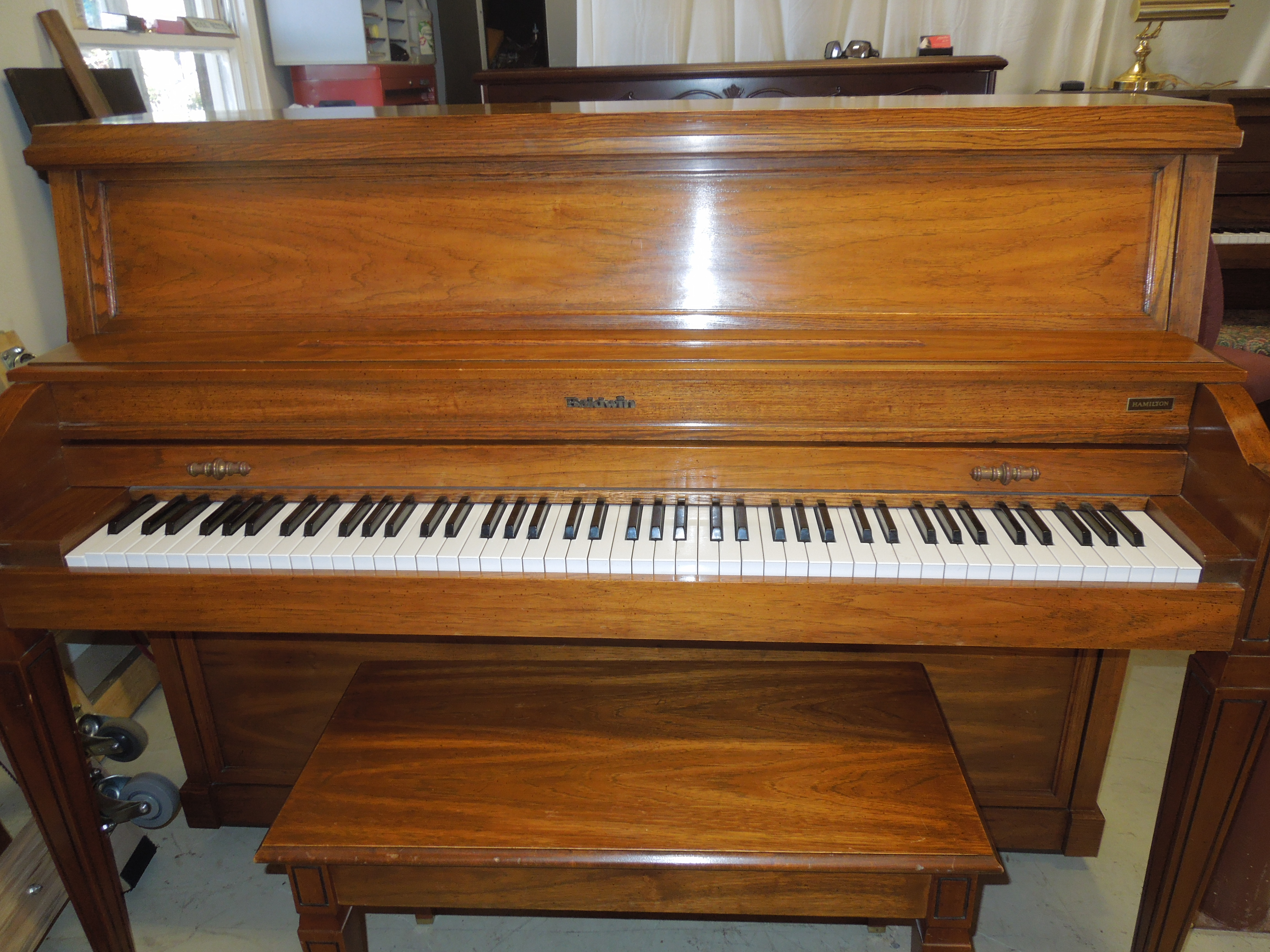 A Beautiful Piano With The String Length Of A Baby Grand