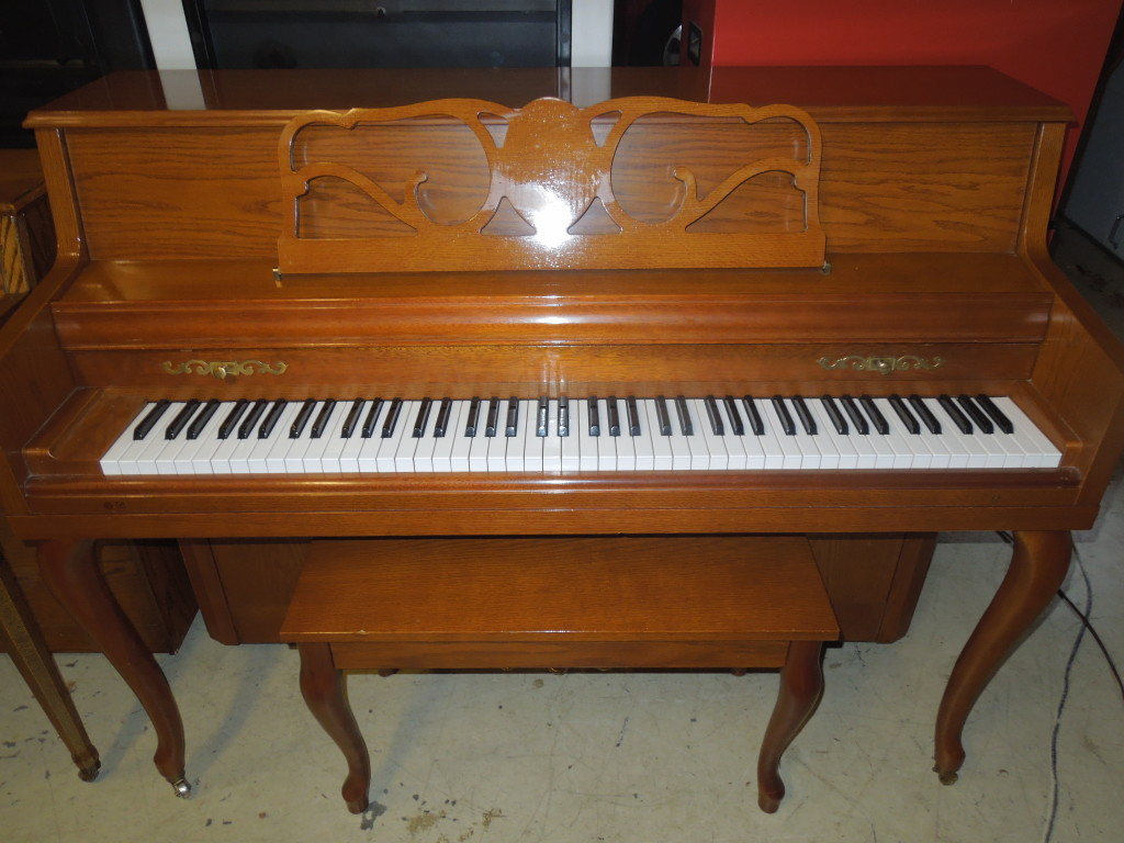 Like new console piano  $1500