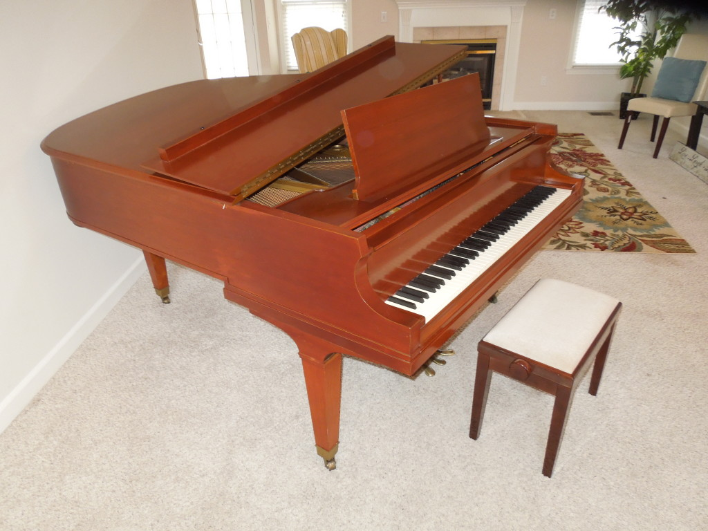 "BEAUTIFUL BALDWIN 6'3"" GRAND WITH A CHERRY FINISH  PRISTINE CONDITION  $9999"